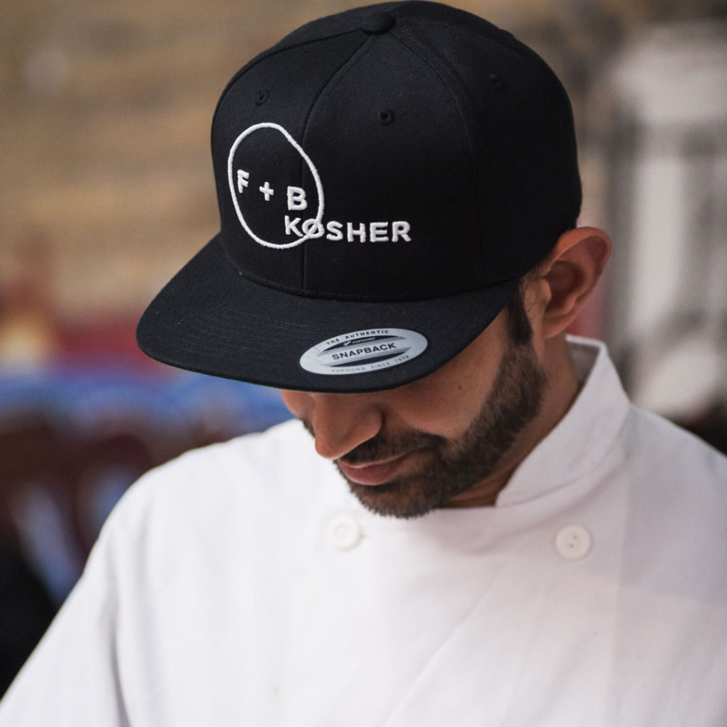 F+B Kosher catering chef wearing hat