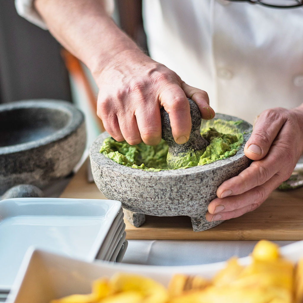Chef making guacamole at a kosher event