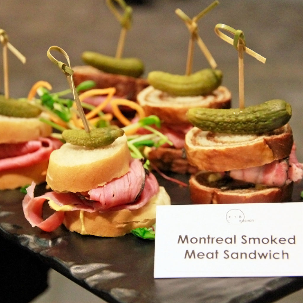 Montreal smoked meat sandwiches on black platter
