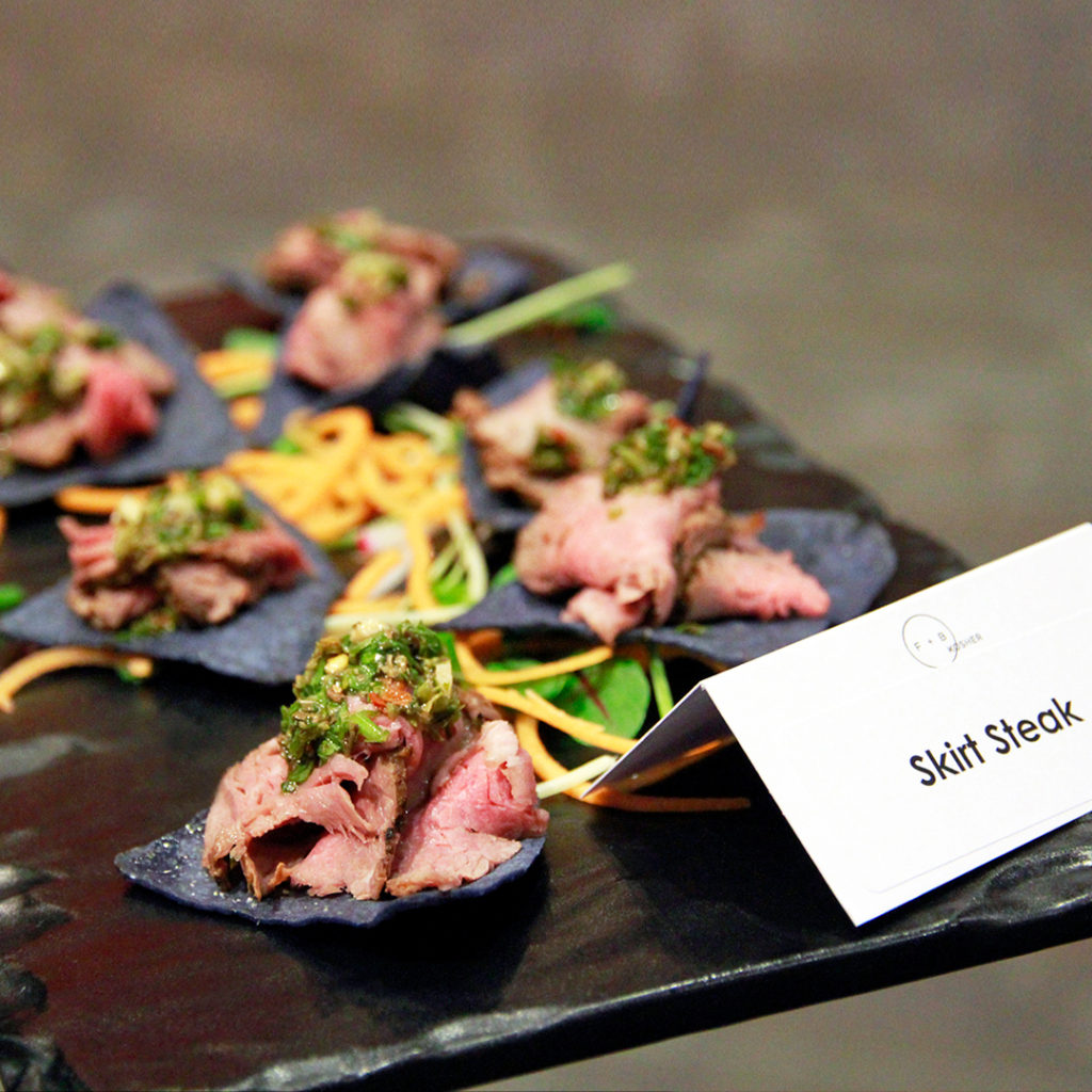 Skirt steak on corn chip with chimichurri