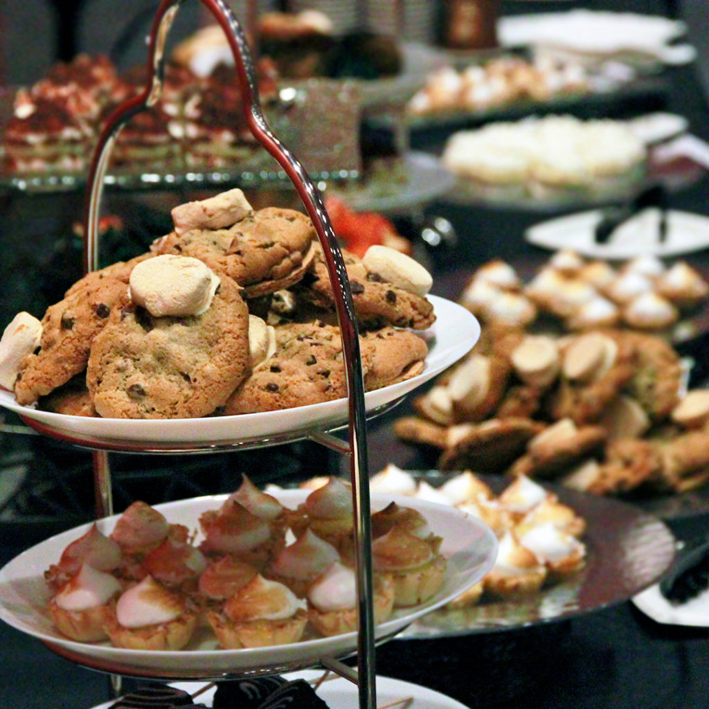 Smoked cookies on display as part of a dessert table at kosher event