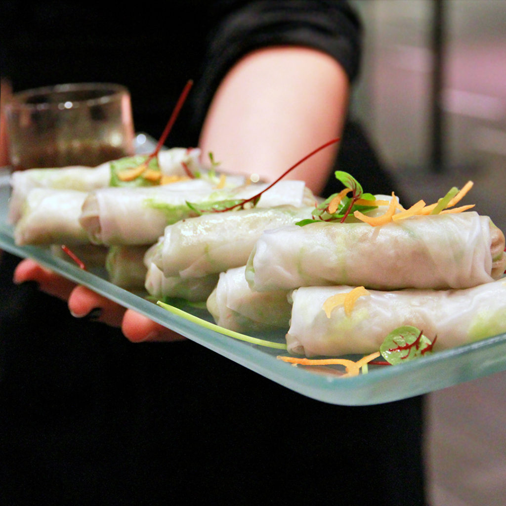 Vegetarian spring roll wraps served at an event